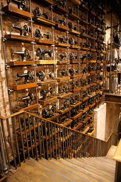 493 Singer Sewing Machines on wall at AllSaints Soho! The UK brand of vintage - looking street clothes. By GQ