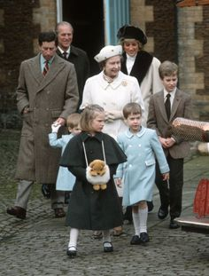 Zara Phillips with her hands in an adorable muffler, Prince Charles walks with his youngest son, Harry, William  walks in front of his grandmother, the Queen, Peter Phillips, walks alongside of her, and Prince Philip and Daughter-in-Law Princess Diana follow behind.