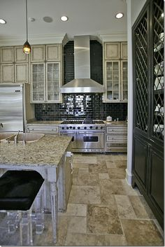 In love with this kitchen...check out the bar stools...so cute!  Check out this entire blog...you will thank me!