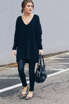 leather leggings, an oversized sweater and leopard flats that enliven the outfit