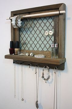 Rustic Barnwood - Mint And Coco Quatrefoil Pattern - Jewelry Holder. The dowel at the top needs to be stained and the hardware could be nicer......but cute idea.