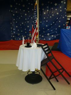 this table was set to honor soldiers killed in action. Military Honors, Military Party, Army Party, Military Retirement, Military Ball, Military Wedding, Banquet Decorations, Patriotic Decorations, Air Force Ball