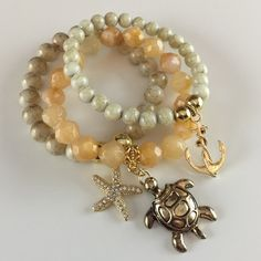 Bracelet Set Three piece acrylic stretch braver set with gold tone metal turtle, anchor and Crystal star fish charms. D.Green Designs Jewelry Bracelets