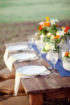 I love these colors ~ blue/white on table and yellow/orange flowers.