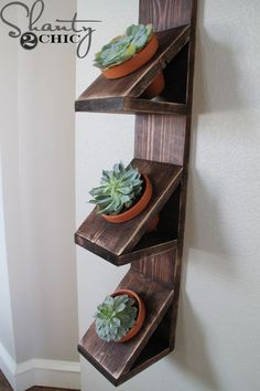 Hey there! Join us on Instagram and Pinterest to keep up with our most recent projects and sneak peeks! We LOVE succulents. They are low maintenance and oh so cute! I have a blank wall in my dining room that is a narrow space and I haven't known exactly what I wanted to put there. {...Read More...}