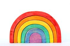 My wooden rainbow stacking toy is sure to become a favorite. When they arent being stacked and put together like a puzzle, the arches can