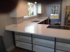 Sleek Gray Cabinets with ColorQuartz Frost White Countertops Gray Cabinets, Kitchen Cabinets, White Countertops, Dates, Frost, Home Decor, Grey Cabinets, Restaining Kitchen Cabinets, Homemade Home Decor