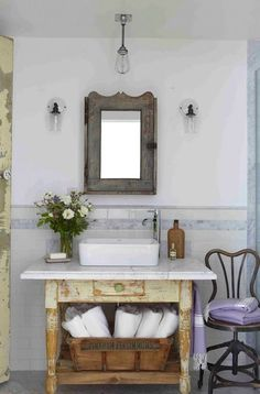Using a farm table with a marble top as a bathroom sink.