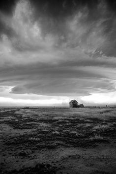 A supercell thunderstorm approaches an abandoned house in Colorado. Supercell Thunderstorm, Thunderstorms, Storm Photography, Farmhouse Wall Art, Grass Field, Black And White Pictures, Abandoned Houses, Wall Art Decor, Colorado
