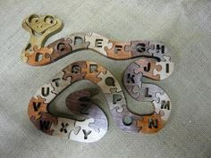 Wooden Alphabet Snake Puzzle by DANSNOWSWOODENTOYSANDGIFTS for $30.00