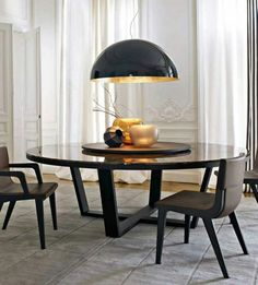 Round dinning table with a lazy susan. I feel like a round table would work better for a large family.... I want to switch to round, and this is perfect.