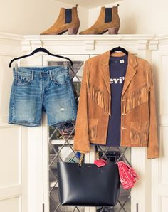 """""""I call this one, 'the festival look'. Vintage fringe suede jacket, distressed boyfriend Levi's shorts, mixed with a vintage inspired tee, Saint Laurent suede ankle boots and a oversized tote. Perfect for any music festival weekend!"""" —Chloe  """"This look feels very Americana inspired. The vintage tan suede fringe jacket paired with the blue denim shorts sets a western tone."""" —Marie-Lou"""