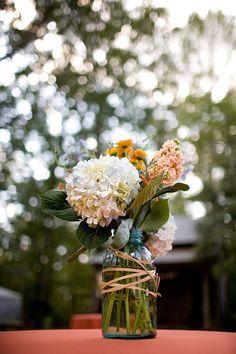 Great idea for flower arrangement, smaller arrangements, smaller mason jars then in a basket.