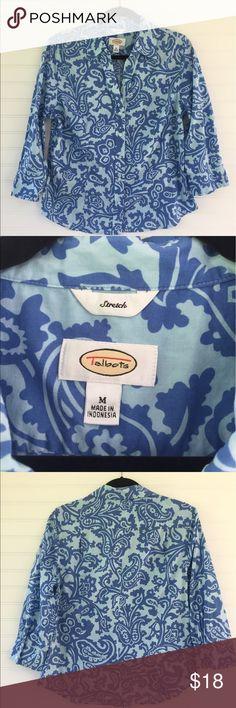 Talbots Buttondown Beautiful blue on blue classic button down from Talbots.  Damask pattern fabric is cotton/spandex blend so there is some stretch for comfort.  Buttons begin 6 inches from neck for a bit of a V neck effect.  3 buttons at each wrist.  Bust is 38 inches around with some stretch to fabric.  The top is 24 inches long.   Perfect condition.  Smoke free. Talbots Tops Button Down Shirts