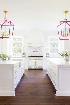 A pop of color provided by vibrant pink hanging lanterns is a simple way to brighten up your kitchen, regardless of the time of year. Open up the windows to let natural light shine into your kitchen and make it feel like summer year-round. Click through for more on this and other summery interior design ideas.