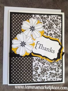 """""""Thanks"""" homemade card is stamped with two black and white flowers on top of a yellowish gold paper and has black ribbon and pretty black and white papers. Insi"""