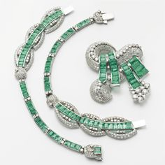 Emerald and Diamond Necklace/Brooch Combination, circa 1940. The center designed as a ribbon and bow motif set with round diamonds and emerald-cut and shield-shaped emeralds, the balance designed as a ribbon motif set with numerous emerald-cut and calibré-cut emeralds, accented with round diamonds, the total diamond weight approximately 18.00 carats, mounted in white gold, the brooch-pendant is detachable, length 16 inches.