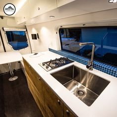 Plenty of space in this converted interior of this Sprinter van by Townsend Travel Trailers. Table drops down into a comfy bed and there's plenty of storage space throughout. Check out more at www.townsendtraveltrailers.com