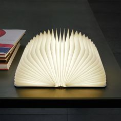 Lumio Book Lamp: Rechargeable LED lamp that folds exactly like a book.