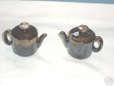 """Pair of Teapot Salt & Pepper Shakers . $8.00. 2-3/4"""" Pair of Pottery Teapot shakers. Made in Japan. Still have the corks. Good condition with no damage.."""
