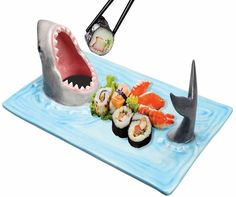 Shark Attack Sushi Platter   Serve your sushi in a funny way with these Shark Attack Sushi Plates from WhatOnEarth. These plates are made of ceramic and painted by hand. The tail is great for holding chopsticks or utensils, while the wide open mouth holds your favourite dipping sauce. Guaranteed to be a conversation piece...  Continued at: http://www.walletwrecker.com/shark-attack-sushi-platter/