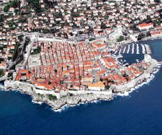 In this amazing aerial photograph we see the beautiful city of Dubrovnik from above. Dubrovnik is a city on the Adriatic Sea coast of Croatia, positioned at the terminal end of the Isthmus of Dubrovnik Wonderful Places, Beautiful Places, Amazing Things, Places Around The World, Around The Worlds, Walled City, Parc National, Famous Places, Birds Eye View
