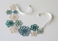 summer souvenirs  handmade tatted floral necklace  by smaks, €30.00. Another stunning example of tatting. The colors are so lovely, and the white ribbon is a great touch.