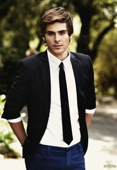 Zac Efron. I mean who doesn't have a crush on this guy? i mean come on! he can sing, dance, act. He has the body, the hair, the sense of style and the face omg.