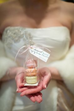 Macaron favors | Photography: Cristina G Photography - cristinagphoto.com Read More: http://www.stylemepretty.com/little-black-book-blog/2014/05/29/chic-spring-brunch-wedding-in-chicago/