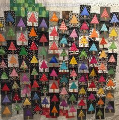 My sewing group is doing a tree exchange for Christmas. Then each of us adds to the initial batch of trees to make our quilt our own. Mine is black/white/brights! 🎄🎄🎄