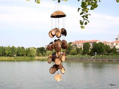 Diy Bird Feeder Discover Coconut Shell Wind Chimes Home Decoration WindChimes For Garden Yard HangingGift for Housewarming Clay Pot Crafts, Diy Home Crafts, Garden Crafts, Cork Crafts, Diy Gifts For Christmas, Christmas Tree, Coconut Shell Crafts, Diy Wind Chimes, Seashell Wind Chimes