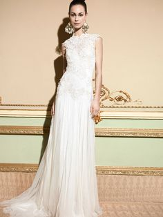 Romanticwedding dress, created with high quality European fabrics, handmade, 100% designed and produced in Barcelona by YolanCris. The dream of haute couture & fashion is reflectedin every detail for you to be perfect onyour wedding day.