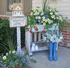 """""""I used an old vintage picket fence to make this potting table. Took a bird house and placed it onto an old architectural post. Using the vintage items brings character and whimsy to the garden."""""""