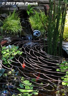 """Ripple"" grate over the pond keeps out wildlife and would also keep small children safe."