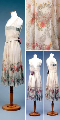 Evening gown, ca. 1918-1920. Sheer, off- white, floral design on bottom half of skirt: pinks, green, yellow blue and gold. Goldstein Museum of Design, Univ. of Minnesota