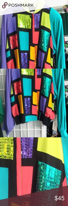 Limited edition silk bomber jacket by Diane Gilman 100% silk bomber style jacket in a multicolor geometric pattern, reminiscent of a Mondrian-print. Sequinned sections on the front with solid black back, elasticized long sleeves and short stand collar.  Hand wash.  Size S never worn. Diane Gilman  Jackets & Coats