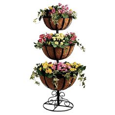 Showcase blooming faux florals and lush spring greenery with this beautiful tiered planter.     Product: PlanterConstructi...