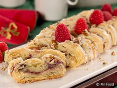 Raspberry Nut Cheese Danish - This is sure to be a seasonal favorite every Christmas season! This fruity pastry doubles as a party dessert and a sweet holiday breakfast.
