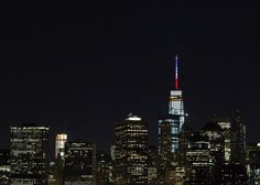 The spire of One World Trade Center lit up in blue, white, and red—the colors of the French flag—to show solidarity with France on Friday night after the t