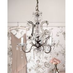 The Sienna Chandelier in our boutique showroom will add a whimsical, ethereal quality to any home.