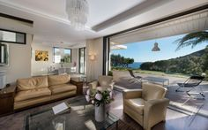 Exclusive Villa Holiday with Uninterrupted Views: Luxury Living Room Design With Leather Seating Units And Luxury Chandelier Decorated With ...
