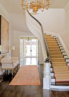 curve to the staircase; and I love when you can see from the front door all the way to a rear door - this one is lovely with those french doors