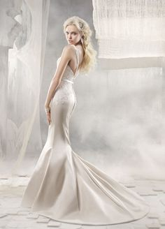 Alvina Valenta Style AV9256 (Candlelight silk faced duchess soft fluted bridal gown with an inverted center back skirt pleat. Ivory Alencon lace bodice with V neck front and back, thin satin ribbon at the natural waist.)