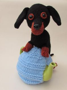 Looking for your next project? You're going to love Dachshund Tea Cosy Knitting Pattern by designer susan_teacosyfolk.