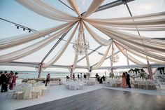 We're completely in awe of this perfect destination wedding in Mexico! Olivia and Joel's wedding is truly beachside perfection as they celebrated with a glamorously decorated tent reception on the beach after their traditional church ceremony. The ceiling draping and chandeliers completed the glam decor as the tables were stunningly set with gorgeous floral table runners, […]