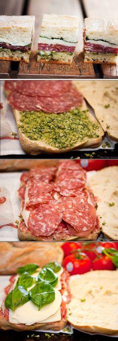 Pressed Picnic Sandwiches: 1 large loaf ciabatta, 3-4 T fresh pesto, ¼ lb sliced sweet sopressata, 3-4 slices prosciutto, 3-4 slices provolone, 3-4 slices mozzarella, 6-8 basil leaves