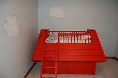 This is Oliver's amazing snoopy bed that my husband built (I painted it).