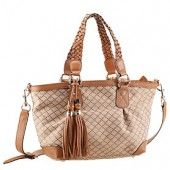 The criss-cross pattern embroidery on beige canvas fabric matches the elegance of the tan leather trimmings that highlight this beautiful tote
