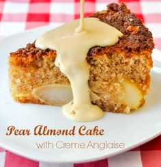 Pear Almond Cake with Creme Anglaise - A wonderfully moist and nutty flavored cake with sweet pears baked right in and served with warm Creme Anglaise custard. A superb cold weather comfort food dessert.
