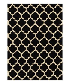 Instantly transform any floor with this hand-tufted rug. Not only does it tie a room together, it provides a soft surface for toes too. Talk about happy feet!Available in multiple sizesRug thickness: 0.22''PolyesterImported